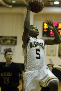 Mosley playing basketball for the Monticello Mustangs