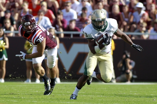 Aug 30, 2014; Blacksburg, VA, USA; William & Mary Tribe running back Kendell Anderson (23) rushes the ball against the Virginia Tech Hokies at Lane Stadium. Mandatory Credit: Peter Casey-USA TODAY Sports