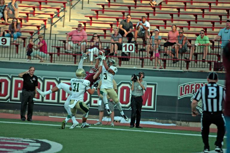 Aaron Swinton goes up for his end zone interception [via tribeathletics.com]