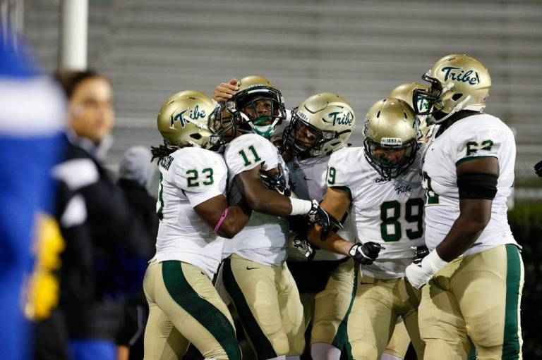 DeVonte Dedmon celebrates his 89-yard kickoff return for a TD in the first quarter. [via tribeathletics.com]