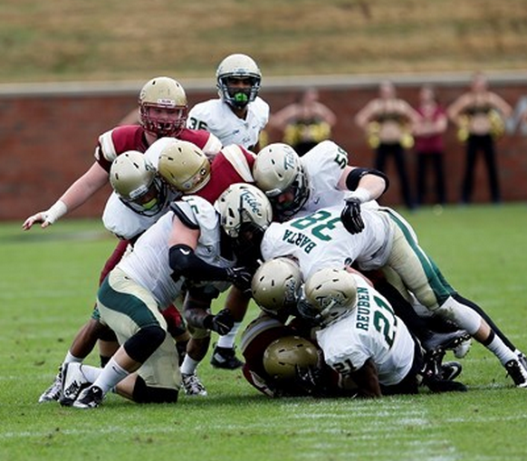 The Tribe defense swarmed. [photo: Pete Clawson, tribeathletics.com]