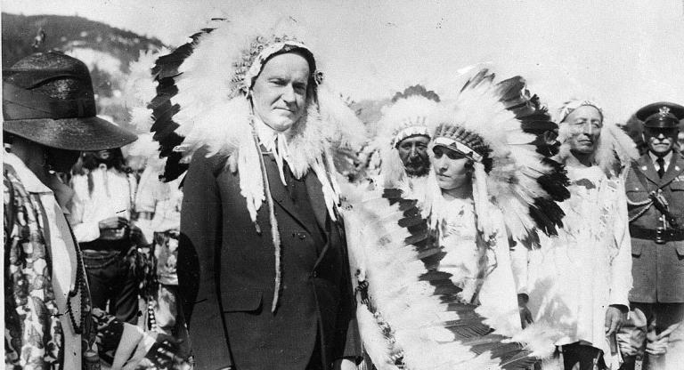 In 1927, President Calvin Coolidge wore a Native American Indian headdress of the Sioux tribe as he was adopted as Chief Leading Eagle. The irony of him wearing this for W&M history is rich. (AP Photo/File)