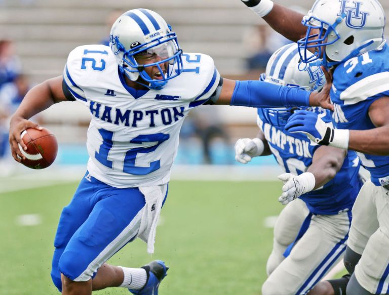 Hampton's QB Jaylian Williamson is no joke, with over a dozen starts under his belt, including one against W&M in 2014. [photo: Aileen Devlin, Virginia Pilot]
